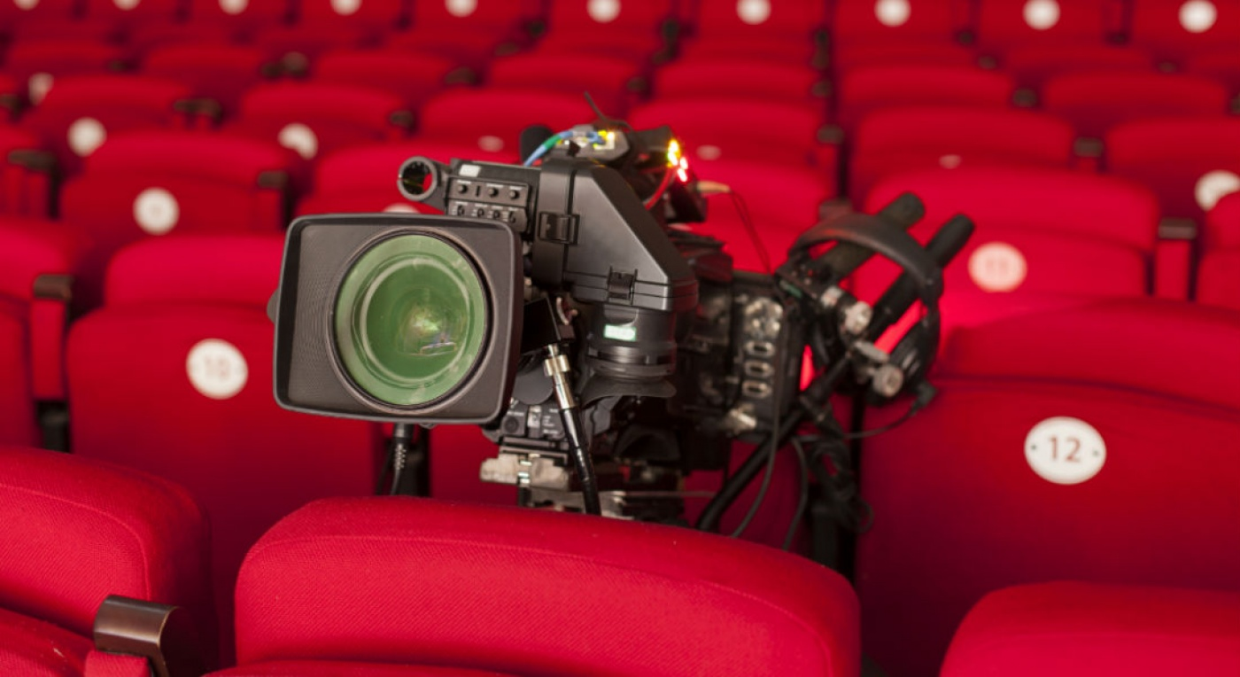Camera in an empty theatre, in the seat facing the stage