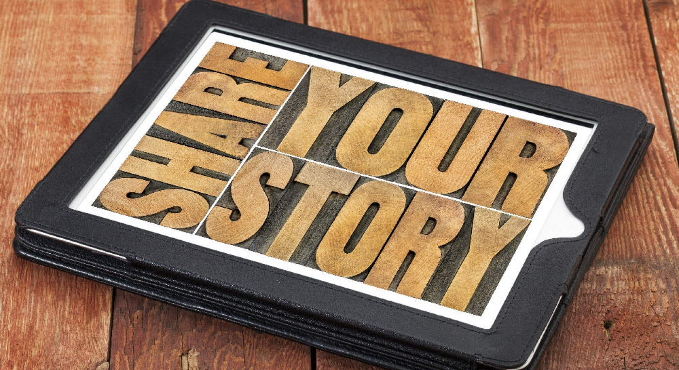 iPad with share your story words