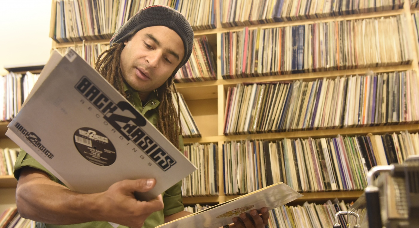 Mala looking at records - John Peel Archive