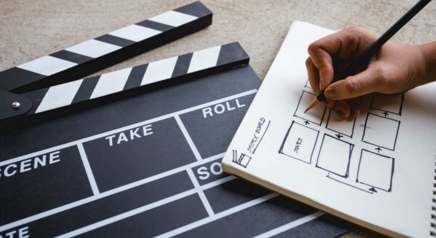 Illustrating storyboard on a clapper with a play logo in the middle