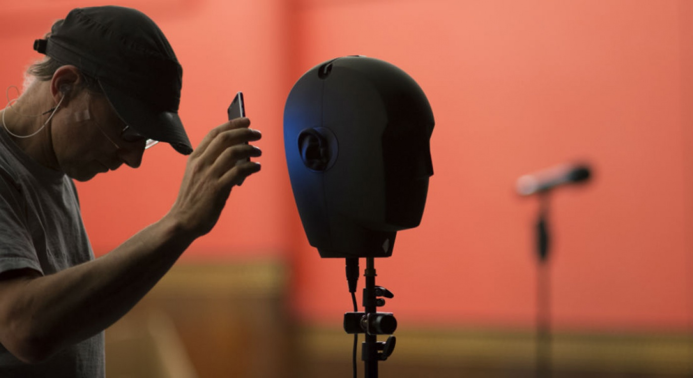 Simon McBurney Artistic Director at Complicate demonstrates the binaural dummy head onstage