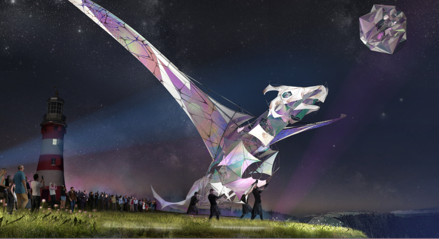 An animated image of a large puppet dragon. The dragon is the size of a double decker bus and is watched by a number of people on the ground as it begins to take flight