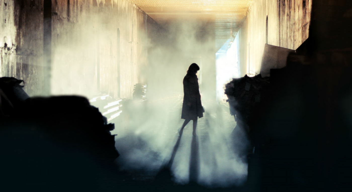 Woman in a building filled with fog