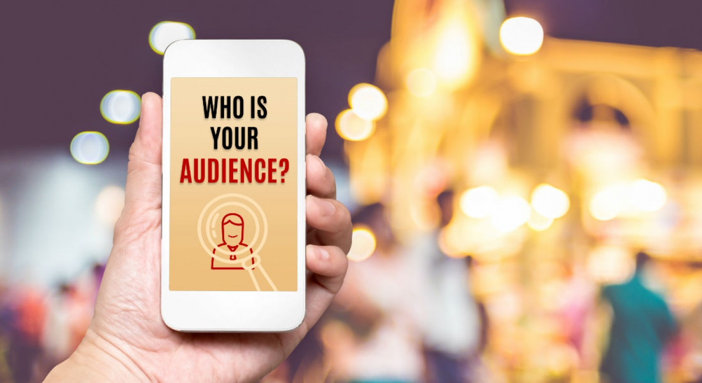 Understand your Audience - man holding phone with text: Who is your audience
