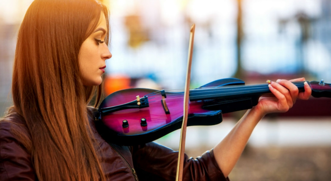 Lady playing violin outside