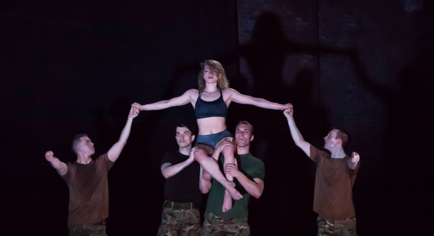 Dancers in army fatigues. 4 males and 1 female.