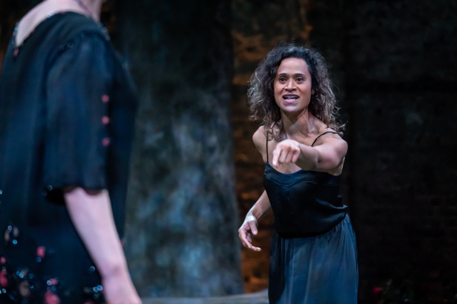 Albion at the Almeida. Angel Coulby (Anna). Photo credit Marc Brenner.  A woman  is outside. She looks aggravated, shouting at another woman and her left arm is outstretched