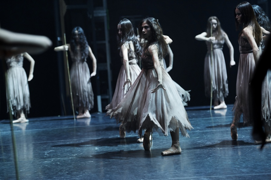 Crystal Costa dancing in ballet shoes and a ragged dress in Akram Khan's production of Giselle by English National Ballet