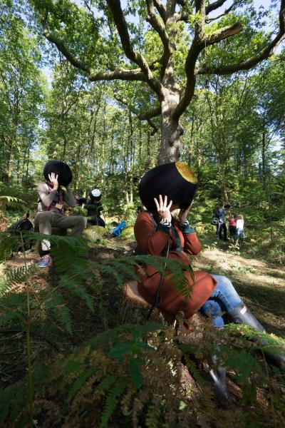People sit in the forest wearing 3D headsets