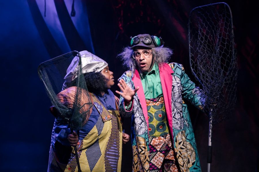 Juliet Okotie and Raj Bajaj, each holding a large net, in wild and colourful costumes for Rapunzel