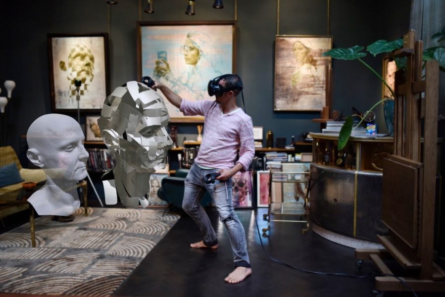Artist Jonathan Yeo in his Chelsea studio using Google Tilt Brush to create a self-portrait sculpture in virtual reality from a 3D scan of himself